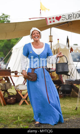 Ardingly Sussex UK 8th June 2018 - Sian Bailey from the Hartley Companie , a medieval reenactment group at the South of England Show in beautiful sunny weather held at the Ardingly Showground near Haywards Heath Sussex Credit: Simon Dack/Alamy Live News - Stock Photo