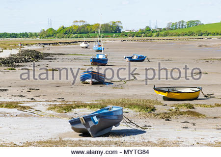Boats moored in the Lune Estuary near to Sunderland Point on the Lancashire Coast near Lancaster - Stock Photo