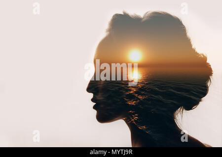 Psychology concept. Sunrise and woman silhouette. - Stock Photo