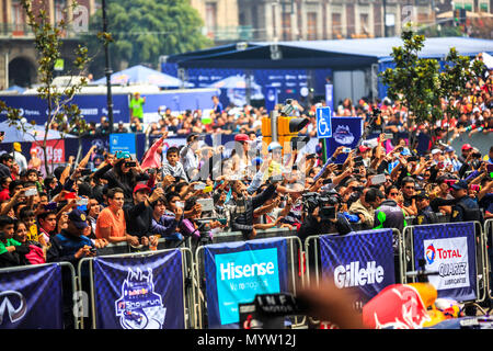 Mexico City, Mexico - June 27, 2015: The audience taking pictures and video to Daniel Ricciardo, at the Infiniti Red Bull Racing F1 Showrun. - Stock Photo