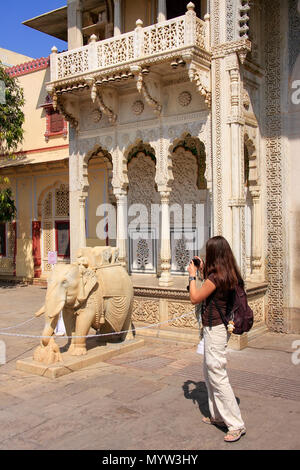 Tourist taking photo of Rajendra Pol in Jaipur City Palace, Rajasthan, India. Palace was the seat of the Maharaja of Jaipur, the head of the Kachwaha  - Stock Photo