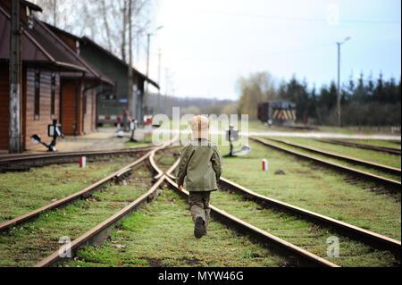 Little,sad boy. Child traveler, wanderer. Lost kid. Problems boy. - Stock Photo