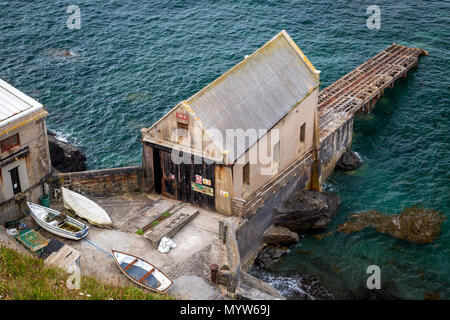 Old Polpeor Cove Lifeboat station (built 1914, closed 1961) at Lizard Point, Cornwall, England - Stock Photo