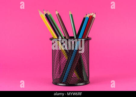 Various of colored pencils in metal basket isolated on pink background. Art and Education concept - Stock Photo