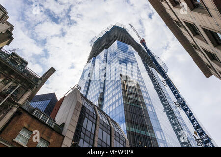 Partially completed skyscraper office tower 22 Bishopsgate in the heart of the financial district of the City of London EC2 reflecting Tower 42 - Stock Photo