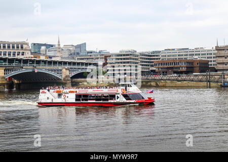 City Cruises riverboat 'Millennium of Peace' sailing past Blackfriars Bridge on a tourist sighseeing cruise tour on the River Thames, London - Stock Photo