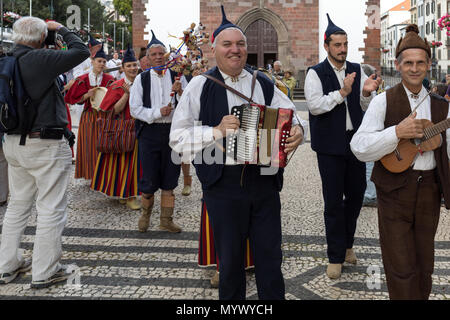 Funchal, Portugal - April 19, 2018:  Folk musicians and dancers performing on the Avenida Arriaga  in Funchal on the Madeira Island, Portugal. - Stock Photo