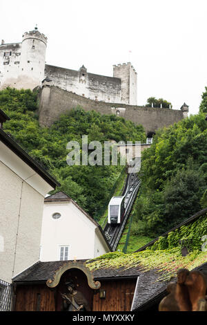 The funicular that travels up to the Hohensalzburg Fortress overlooking Salzburg, Austria. - Stock Photo