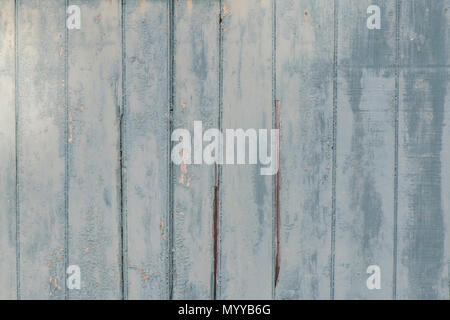 Blue Wall with Chipped and Pealing Paint - Stock Photo