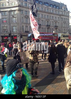 London, UK. 17th Jan, 2015. Protestors march down Oxford Street, London to raise awareness of the 20,000 whales, - Stock Photo