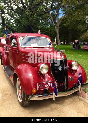 Vintage Red Ford car decorated with Australian flags on display in Kings Domain, Melbourne, Australia. part of RACV - Stock Photo