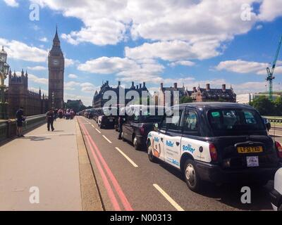 London, UK. 26th May, 2015. London black cab drivers protest against the taxi app uber on Westminster Bridge. Credit: - Stock Photo