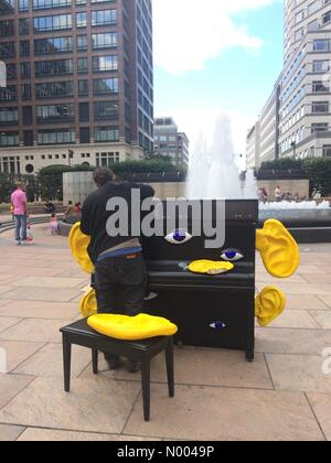 London, UK. 12th Sep, 2015. Piano technician sets up a public piano in Canary Wharf, London, UK. Credit:  Glenn - Stock Photo