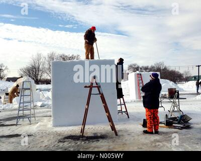 Minnesota, USA. 29th Jan, 2016. Teams work on giant blocks of snow at the snow sculpting competition at the St. - Stock Photo