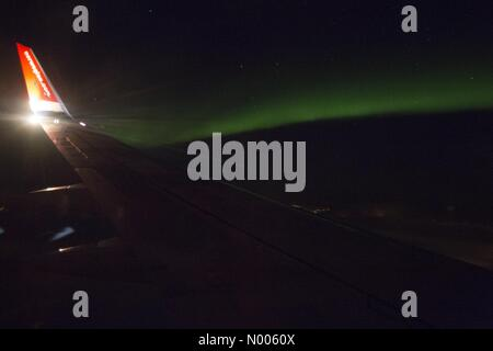 Norway. 10th February, 2016. Northern light photographed from a Norwegian airplane on its way from Oslo to Bardufoss, - Stock Photo