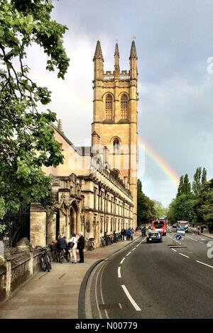High St, Oxford, Oxfordshire, UK. 23rd May, 2016. UK Weather. A rainbow shines over Magdalen Tower, just before - Stock Photo