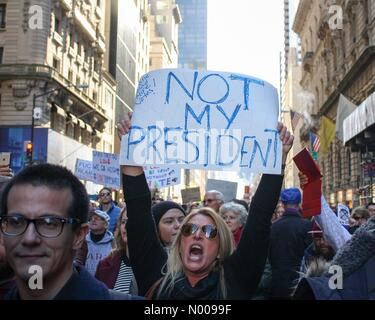 New York, New York, USA. 12th Nov, 2016. Woman holdinhsignshouts at NYC protest against Donald Trump Credit:  BumbyPix - Stock Photo
