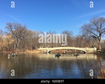 New York, USA. 23rd Feb, 2017. Boating on the lake in New York's Central Park during unseasonably warm weather in - Stock Photo