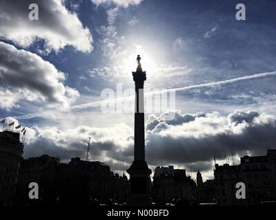 London, UK. 06th Mar, 2017. UK Weather: A crisp, spring morning as the sun shines from behind Nelson's Column in - Stock Photo