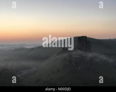 Wareham, UK. 10th May, 2017. UK Weather: Sunrise over Corfe Castle. Wareham, Dorset. 10th May 2017. High pressure - Stock Photo