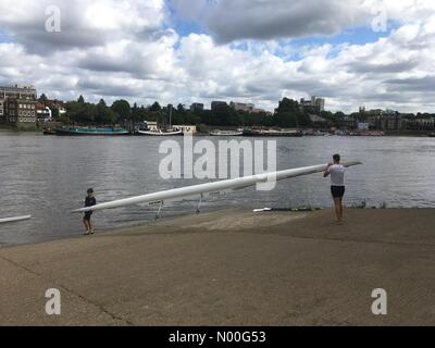 London, UK. 04th Aug, 2017. UK Weather: Rowers on river Thames. Rowing boats take to the water on the river Thames - Stock Photo