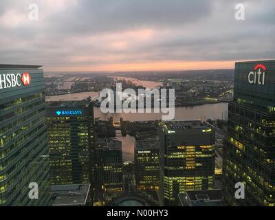London, UK. 21st Nov, 2017. Sunrise over Canary Wharf looking across the River Thanes. Credit: Rob Carter/StockimoNews/Alamy - Stock Photo