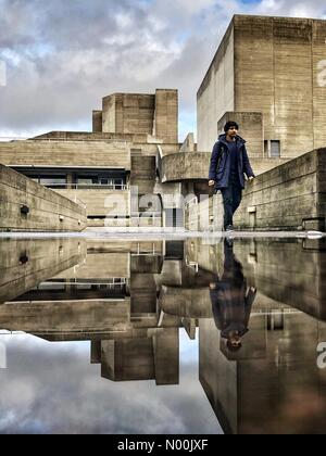 London, UK. 15th Jan, 2018. UK Weather: A man reflected in a puddle walking past the National Theatre after the - Stock Photo