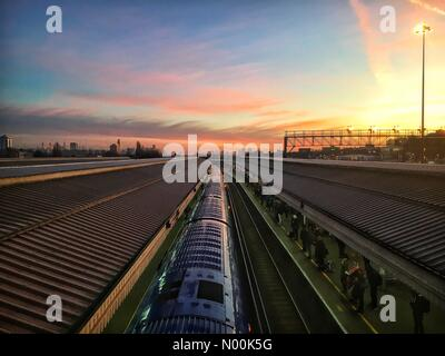 London, UK. 30th Jan, 2018. UK Weather: Colourful sunrise over London as seen from Clapham Junction station Credit: - Stock Photo
