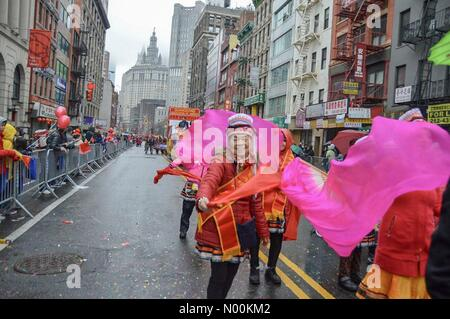 New York City, USA. 25th Feb, 2018. Participants march during the Chinese New Year Parade in ChinaTown, New York, - Stock Photo