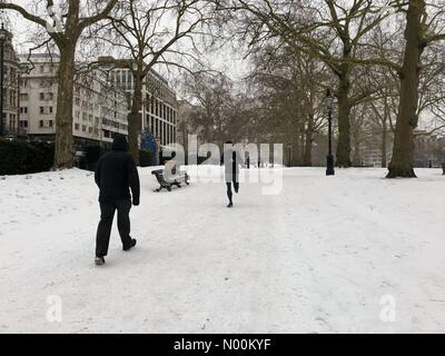 London, UK. 01st Mar, 2018. Green Park in London under the blanket of snow on the first day of spring. Green Park, - Stock Photo