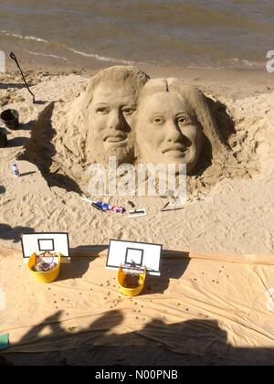 London, UK. 19th May, 2018. 20th may 2018 London UK A sand sculpture of Prince Harry and Meghan was sculpted by the river Thames by a Street artist on the royal wedding day Credit: Emin Ozkan/StockimoNews/Alamy Live News - Stock Photo