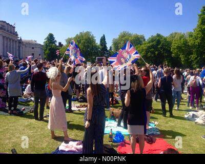London, UK. 19th May 2018. Crowds cheering at live screening of Harry & Meghan's Royal Wedding in Greenwich London England Credit: cattyy/StockimoNews/Alamy Live News - Stock Photo