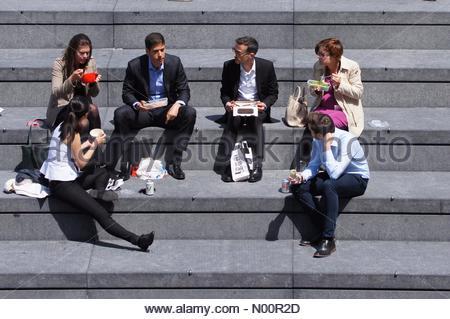 London, UK. 6th June 2018. UK Weather: People enjoy sunny day at the Scoop. Credit: Marcin Rogozinski/StockimoNews/Alamy Live News - Stock Photo