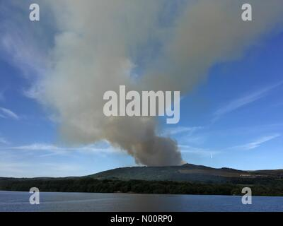 Moorland fires at Rivington in Lancashire. Fires on the moorland near the Winter Hill transmitter and Rivington Pike. Fire started on Thursday afternoon and smoke can be seen from Chorley and Bolton. - Stock Photo