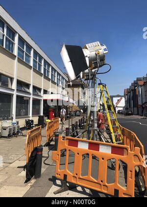 Lighting and film production set up outside the old post office building in Bishops Stortford, Hertfordshire for scene filming of Spider-Man Far From Home - Stock Photo