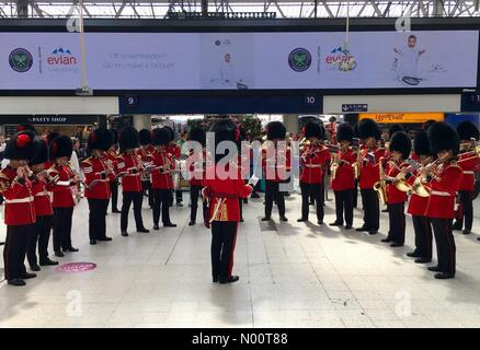 London, UK. 11th July, 2018. Wednesday 11th July 2018 - Waterloo Train Station London - Coldstream Guards orchestra perform to crowds at Waterloo Station Credit: Matthew Woodward/StockimoNews/Alamy Live News - Stock Photo