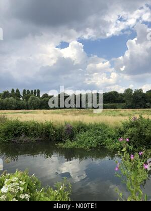 UK Weather: Sunny intervals in Godalming. The Burys, Godalming. 13th July 2018. Rising temperatures this afternoon across the Home Counties with imminent thunderstorms. Building cloud in Godalming. Credit: jamesjagger/StockimoNews/Alamy Live News - Stock Photo