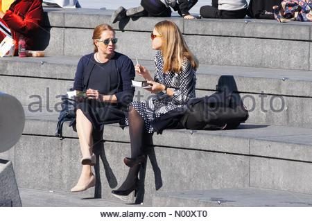 London, UK. 10th Oct 2018. UK Weather: London, UK. 10th October 2018. People enjoy sunny day at the Scoop. Credit: Marcin Rogozinski/StockimoNews/Alamy Live News - Stock Photo
