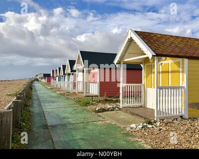Lancing Beach, Sussex. 1st Nov 2018. UK Weather: Colourful beach huts in autumn sun with clouds in the blue sky on Lancing Beach, Sussex, UK Credit: Julia Claxton/StockimoNews/Alamy Live News - Stock Photo