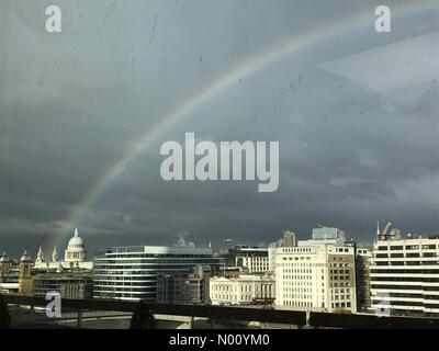 London, UK. 19th November, 2018. St Paul's cathedral with rainbow above, through rainy window Credit: AC Creative/StockimoNews/Alamy Live News - Stock Photo