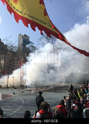 New York City, NY, USA- February 5, 2019: Spectators gather in Sara D. Roosevelt Park to watch the firecrackers explode to celebrate the Chinese New Year. Credit: TD Dolci/StockimoNews/Alamy Live News - Stock Photo