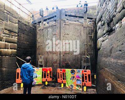 Manchester, UK. 10th Feb 2019. The Canal and River trust open up the renovations of Lock 92 in Manchester to the public. Whilst repairs are undertaken, the lock has been drained giving rare access to visitors. Credit: Binary Image/StockimoNews/Alamy Live News - Stock Photo