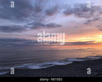 Lyme Regis, Dorset, UK. 11th February, 2019. Glorious sunset over Monmouth Beach at Lyme Regis, Dorset. Credit: Celia McMahon/StockimoNews/Alamy Live News - Stock Photo