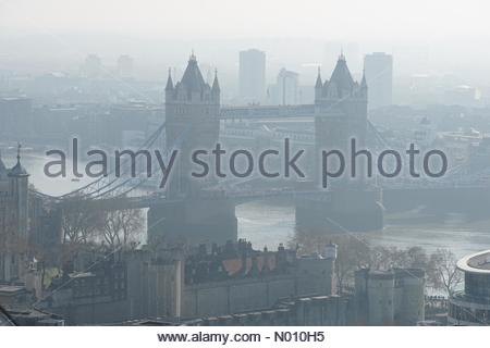 London, UK. 23rd February 2019. Tower Bridge covered in morning fog. Credit: Marcin Rogozinski/StockimoNews/Alamy Live News - Stock Photo