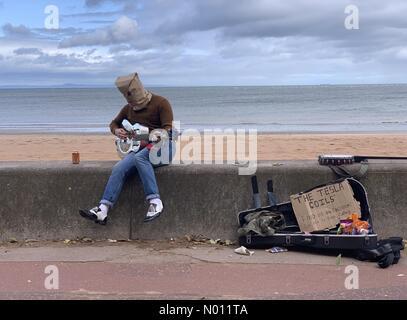 Edinburgh, Scotland, UK. Saturday 31st of August 2019. A performer on the seafront plays the guitar at the Portobello Big Busk in Edinburgh, Scotland. Credit: Andrew O'Brien/StockimoNews/Alamy Live News - Stock Photo