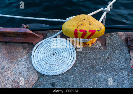 Tall Ships Race 2008. Bergen, Norway - August 2008. Coil of ship mooring lines nicely done at the berth. Bollard no 177 in Bergen harbor. - Stock Photo
