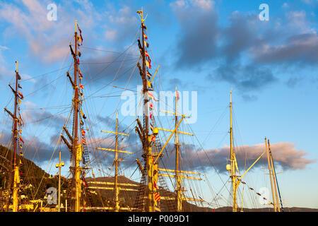Tall Ships Race 2008. Bergen, Norway - August 2008. Masts against mount Ulriken - Stock Photo