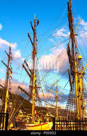 Tall Ships Race 2008. Bergen, Norway - August 2008. Masts against mount Ulriken and Floyen - Stock Photo