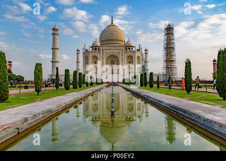 Taj Mahal with reflection on water, Agra, India - Stock Photo