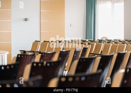 Seminar presentation. Empty conference room, lots of empty seats. Auditorium for workshops and seminars - Stock Photo